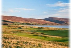View across Brora golf course to the sea and hills