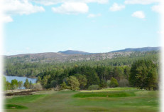 View of Bonar Bridge and Ardgay golf course with the loch and hills